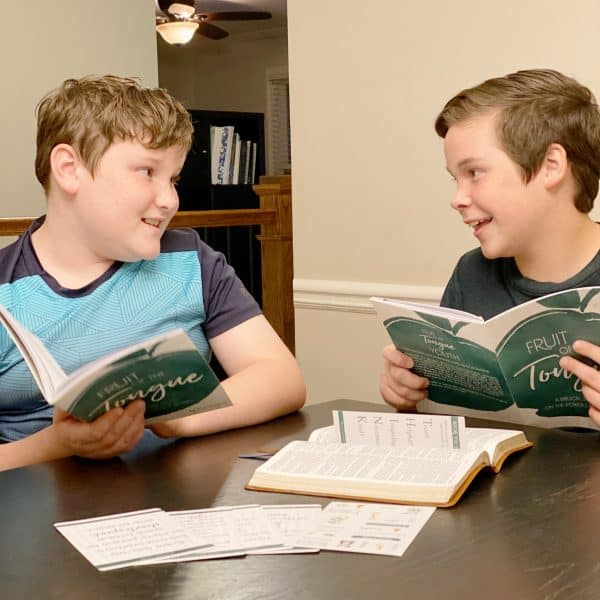 Two boys doing a family Bible study